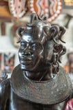 Traditionell afrikansk skulptur - kvinnas huvud Arkivbilder