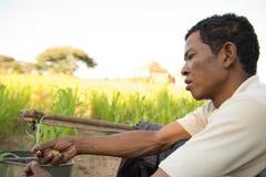 Traditionell asiatisk manlig bonde för stående Fotografering för Bildbyråer