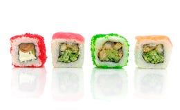 Traditionell japansk mat. Olika rullar på en vitbakgrund royaltyfri bild