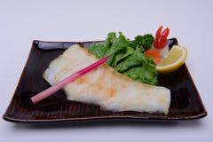 Traditionell japansk mat, Sablefish grillade, eller grillad svarttorsk, Gindara Shio-yaki isolerade på vit bakgrund Royaltyfri Bild