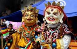 Traditionell mongoliandräkt och maskering arkivfoto