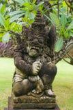 Traditionell skulptur för Balinese i trädgård Arkivfoton