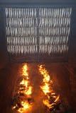 Traditionell strömming som röker process Royaltyfria Foton