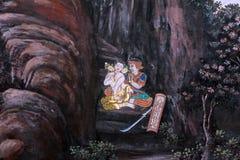 Traditionell thailändsk konstmålning på en vägg Arkivbild