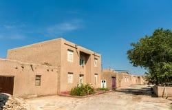 Traditionella hus på den Itchan Kala fästningen i den historiska mitten av Khiva UNESCOvärldsarv i Uzbekistan Royaltyfri Foto