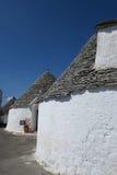 Traditionella vita trullibyggnader Arkivfoto