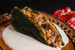 Traditionelle mexikanische Küche Paprikaen Nogada in Puebla Mexiko Lizenzfreie Stockbilder