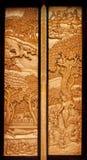 Traditionelle siamesische Artkunst an der Tempeltür. Stockfotos