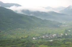Traditioneller Chinese, der Dorf bewirtschaftet Stockfotos