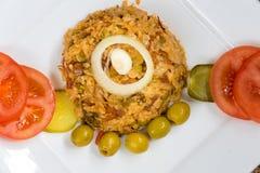 Traditioneller kreolischer gelber Reis der kubanischen Küche Stockfotos