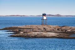 Traditioneller norwegischer Stahlleuchtturm stockbild