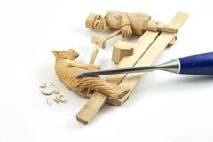 Traditioneller Schmied mit Bärenspielzeug Stockfoto