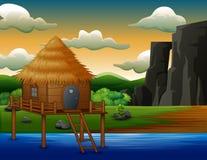 Traditionelles Kabinenhaus über dem Fluss stock abbildung