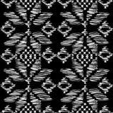 Traditionelles vorbildliches Weiß auf Schwarzem stockbild