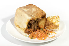 Traditionellt Durban Bunny Chow Showing Curry Gravy Soaked bröd Arkivbild