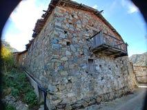 Traditionellt hus för by med balkongen royaltyfria bilder