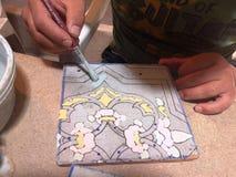 Traditionellt planlägga för tegelplatta Arkivbild