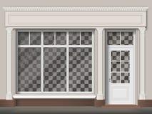 Traditionellt shoppa fasaden med det stora fönstret och kolonner Arkivbilder