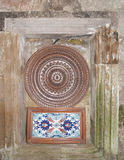Traditionl plate and  tile. Traditional turkish tile and plate on the wall Royalty Free Stock Photo