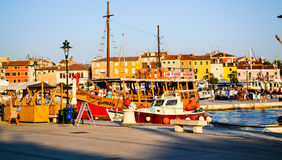 A traditionnal little port in a small city in Croatia. Small port in the sunset Stock Image