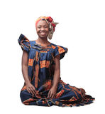 Traditions. Smiling african woman wearing a traditional dress Royalty Free Stock Image