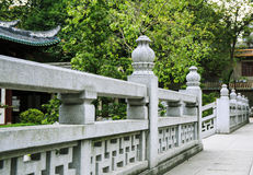 Traditonal Chinese stone balustrade with classical pattern in garden, old marble stone balusters in Asian oriental classic style Royalty Free Stock Photos