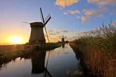 Traditonal windmill in the Netherlands. Traditonal windmill in the countryside from the Netherlands at twilight Royalty Free Stock Images