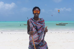 Traditonaly dressed black man on Paje beach, Zanzibar, Tanzania, East Africa. Traditonaly dressed black man with funny sunglasses on Paje beach. Maasai warrior Stock Photos