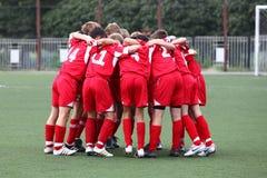 Tradizione di gioco del calcio - abbracci Fotografia Stock