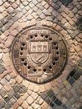 Tradycyjna manhole pokrywa dla ulicznego hatchway w Praga Fotografia Royalty Free