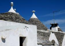 Tradycyjni biali trulli budynki fotografia stock