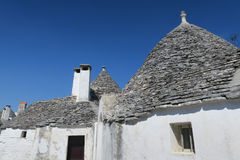 Tradycyjni biali trulli budynki obraz stock