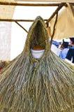 Tradycyjny słomiany deszczowiec przy Feira Franca w Pontevedra, fotografia stock