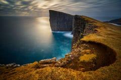 Traelanipa cliffs sunset. Cliffs of Traelanipa on Vagar island in sunset, Faroe Islands Stock Image