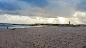 Trafalgar plaża z latarnią morską Zdjęcie Royalty Free