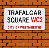 Trafalgar Place Name Sign. The London city place name sign for Trafalgar Square on a red brick wall Stock Image