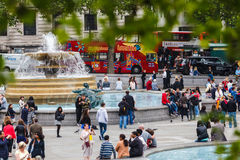 Trafalgar Square. In the beginning of summer in London, England. Many tourists flock to this landmark which was known for the fountains and all the pigeons, but stock photography