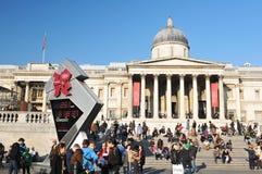 Trafalgar Square in London. London, UK - 18 Nov, 2011: Tourists enjoying the sun in Trafalgar Square, London Stock Photos