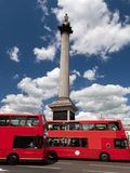 Trafalgar Square in London, the UK. Red bus Royalty Free Stock Photos