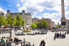 Trafalgar Square with lots of tourists Stock Photography