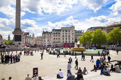 Trafalgar Square with lots of tourists Royalty Free Stock Photography