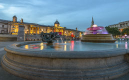 Trafalgar Square at night, London. Trafalgar Square, Westminster, London. Famous fountain and The National Gallery in the background Stock Photo