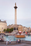 Trafalgar square with people in the evening. LONDON - AUGUST 10, 2015: Trafalgar square with people and tourists at dusk on August 10th, 2015 in London, UK. The royalty free stock photo