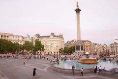 Trafalgar square with people and tourists at dusk in London. Trafalgar square with people and tourists at dusk on August 10th, 2015 in London, UK. The square royalty free stock images