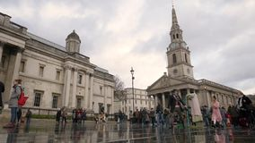 Trafalgar Square and St. Martins-In-The-Fields church, London, UK stock footage