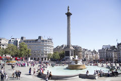 Trafalgar square on a sunny and very busy day Stock Image