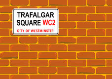 Trafalgar Square Wall. The street name sign from Trafalgar Square on a red brick wall Royalty Free Stock Photos