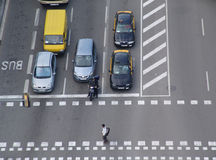 Traffic. Cars and pedestrian at a crosswalk Stock Photos