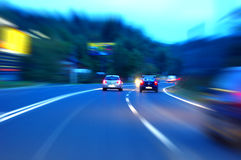 Traffic. Fast moving vehicles on road, busy traffic Stock Images
