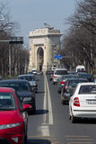 Traffic. On the boulevard Constantin Prezan from Bucharest and the Arc de Triomphe in the plane away.Romania Royalty Free Stock Photos
